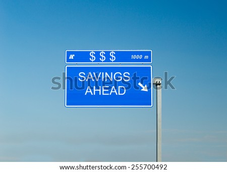 Road sign with Dollar sign and the words savings ahead and sky in the background