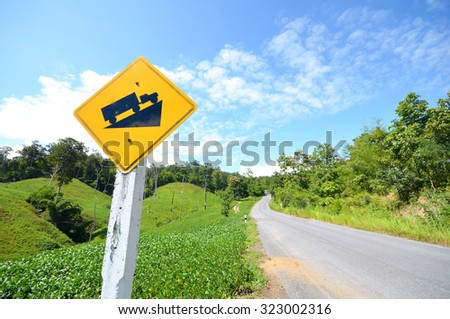 Road sign with green mountain background - stock photo