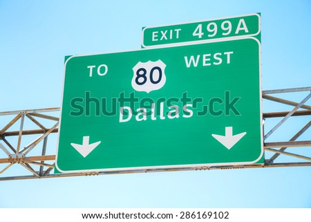 Road sign with the direction to Dallas, Texas - stock photo