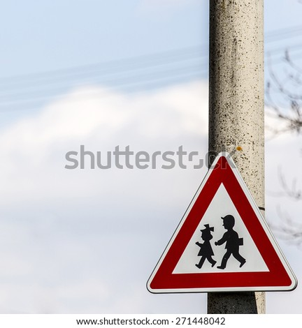road sign with warning - protection of children near school or nursery - stock photo