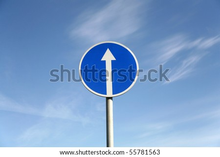 Road signs against a blue sky - stock photo