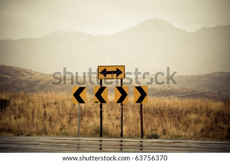 Road signs at the end of the road pointing left and right