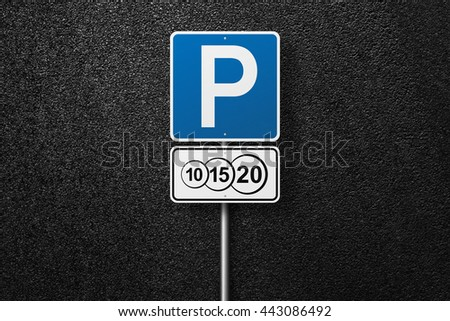 Road signs. Behind the signs one can see a smooth asphalt road. Paid parking. The texture of the tarmac, top view. - stock photo