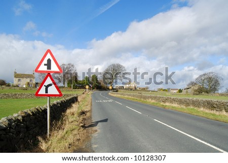 Road signs on country road in Yorkshire Dales - stock photo
