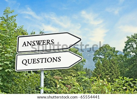 Road signs to answers and questions - stock photo