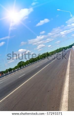 Road   sky  clouds   sun - stock photo