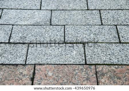 Road stone pavement texture, grey bricks pattern - stock photo