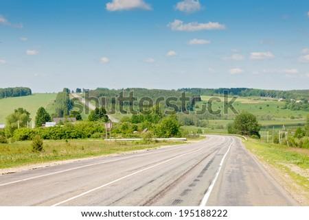 road stretches into the horizon - stock photo