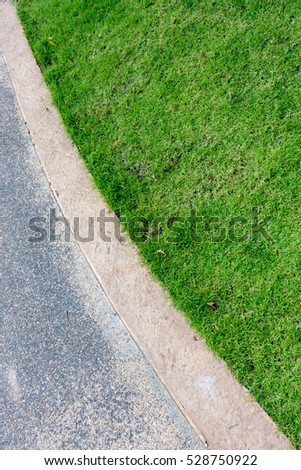 Road surface with grass