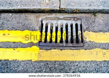 road surface with manhole - stock photo