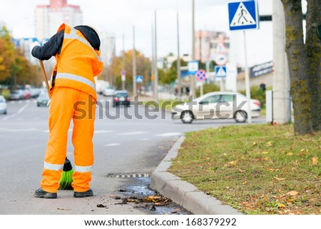 Road Sweeper cleaning street with broom tool - stock photo
