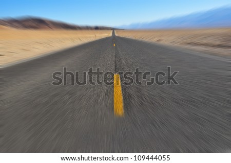 Road that goes to the horizon with motion blur applied