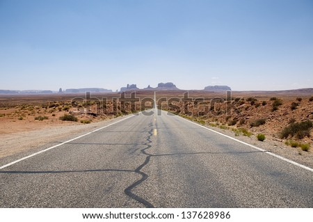 Road that takes us to Monument Valley called Highway 163. It is a region characterized by a cluster of vast sundstones buttes, it'??s located between Arizona and Utah, United States of America. - stock photo