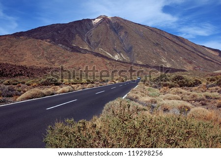 Road through El Teide national park, Canary Islands. Volcano Teide.Volcanic landscape with road.