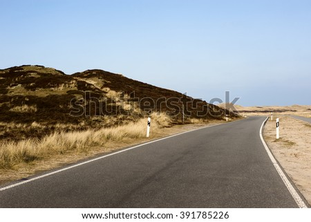 Road through island Sylt in the North Sea