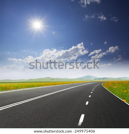 Road through meadow with cloud and sky background