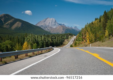 Road through Rockies. Great summer day. - stock photo