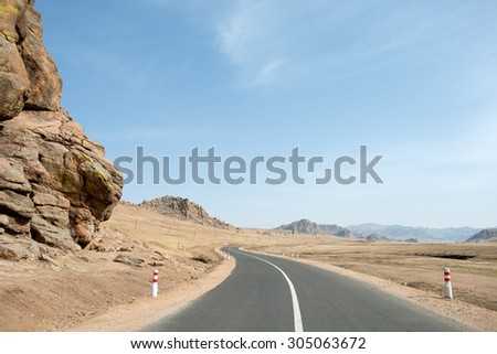 Road through Terelj National Park, in Mongolia - stock photo