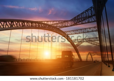 road through the bridge with sky background of a city - stock photo