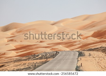 Road through the desert in Liwa Oasis area, Emirate of Abu Dhabi, Untied Arab Emirates - stock photo