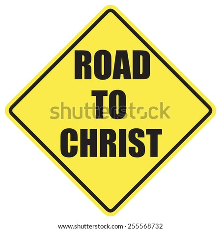 Road to Christ sign with black letters over a yellow background