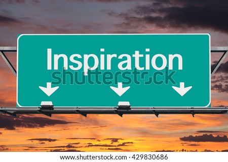 Road to inspiration highway sign with sunrise sky. - stock photo