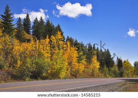 "Road to national park ""Glacier"" in autumn paints"
