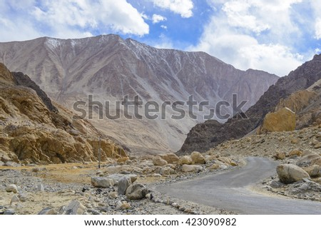 Road to Pangong Lake with light and shade on mountain - stock photo