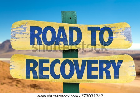 Road to Recovery sign with desert background - stock photo
