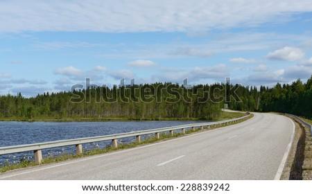 Road to shoreline. Finland, Lapland - stock photo