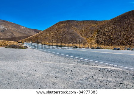 Road to Somewhere. A New Zealand road disappearing into the distance  South Island mountain range - stock photo