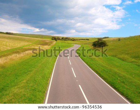 Road to Success. An endless road taking you to the bright future. - stock photo
