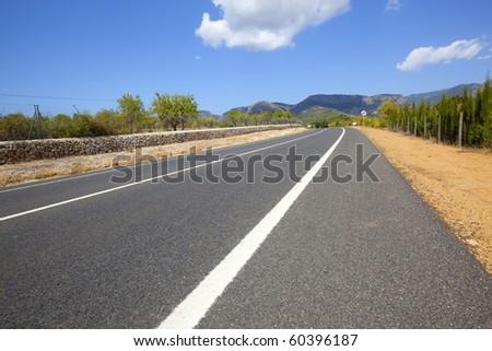 road to the mountains - stock photo