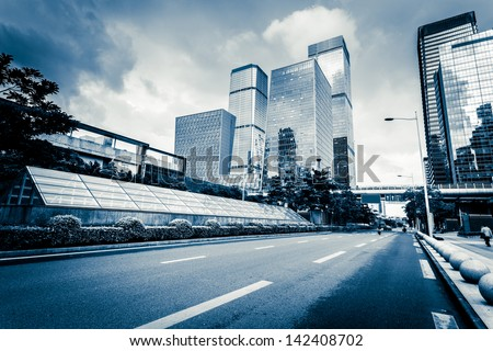 Road to urban city - stock photo