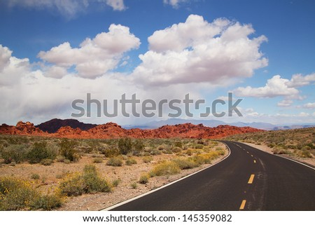 Road to valley of fire with beautiful blue sky full of clouds
