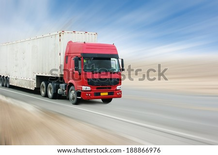 Road transport of goods in the truck. - stock photo