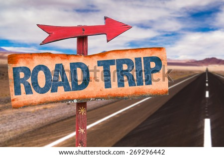 Road Trip sign with road background - stock photo