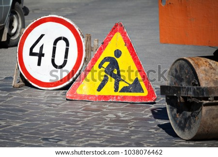 Road under construction and speed limit sign
