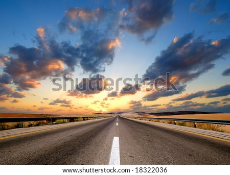 road under dramatic sky - stock photo