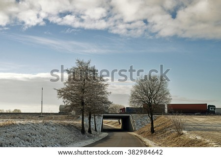 Road under highway in a tunnel - Jutland, Denmark - stock photo