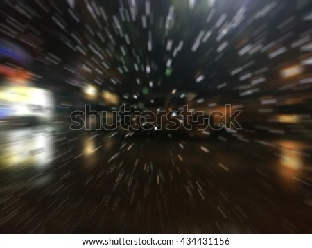 Road view through car window with rain drops, Driving in rain at night - stock photo