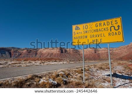 Road warning sign about steep Moki Dugway, Utah - stock photo