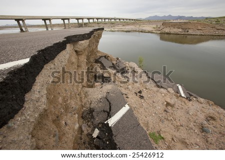 Road washed out by flood in Arizona desert.