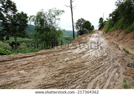 road wet muddy of backcountry countryside - stock photo