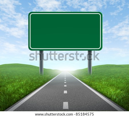 Road with blank highway sign with green grass and asphalt street representing the concept of journey to a focused destination resulting in success and happiness. - stock photo