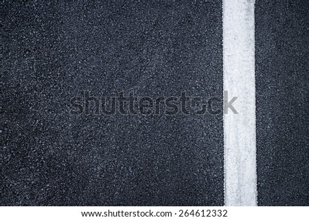 road with dividing white stripes