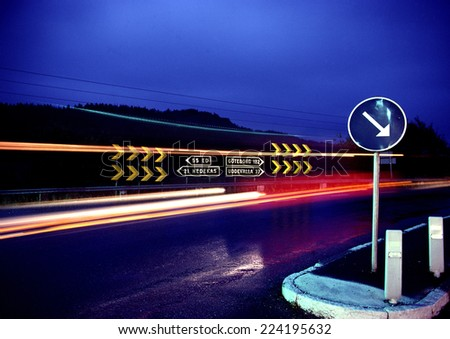 Road with light trails at night - stock photo