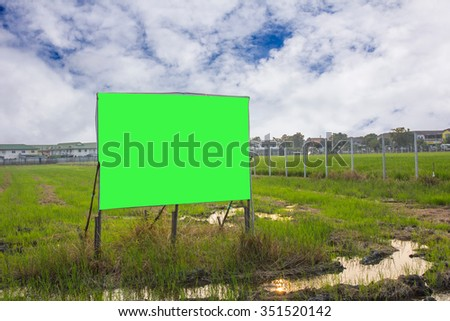 road with sign pole and blue sky with clouds,chroma key green - stock photo