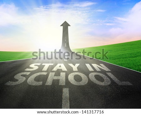 Road with up arrow sign and stay in school text written on the road