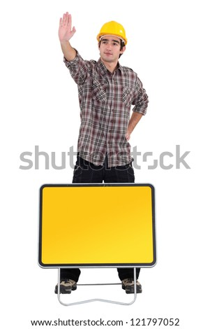 road worker making a stop sign with his hand - stock photo